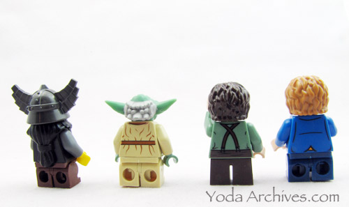 rear view of mini action legs, Dwarf with reddish-brown, Yoda w/tan, Frodo in normal, and Bilbo with dark blue.
