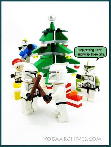 lego clone troopers under a christmas tree. two are playing lightssabers with empty wrapping papers tubes