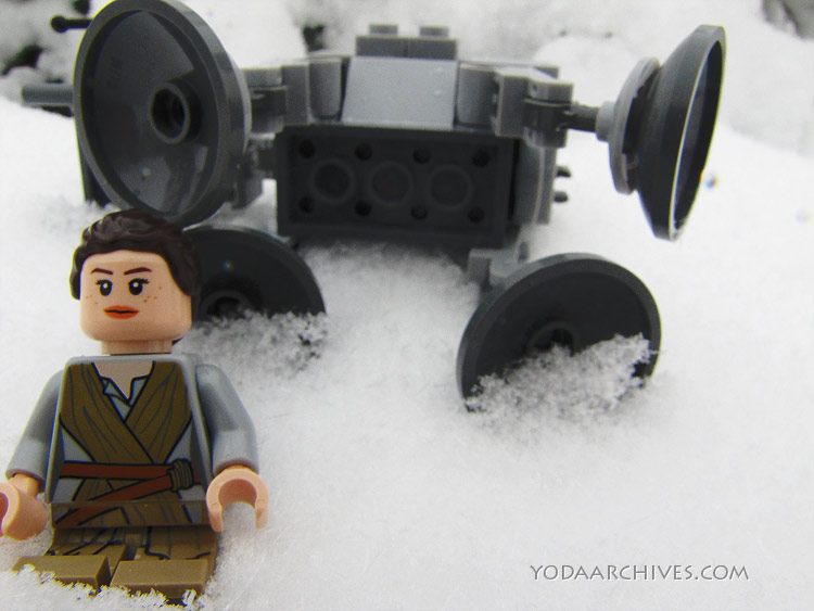 lego rey minifig sitting a foot of fallen microfighter AT-At