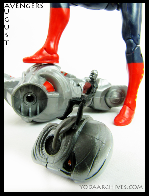 In the foreground antman stands on ultron's head, in the back ground Captain Marvel standing on Ultron's torso