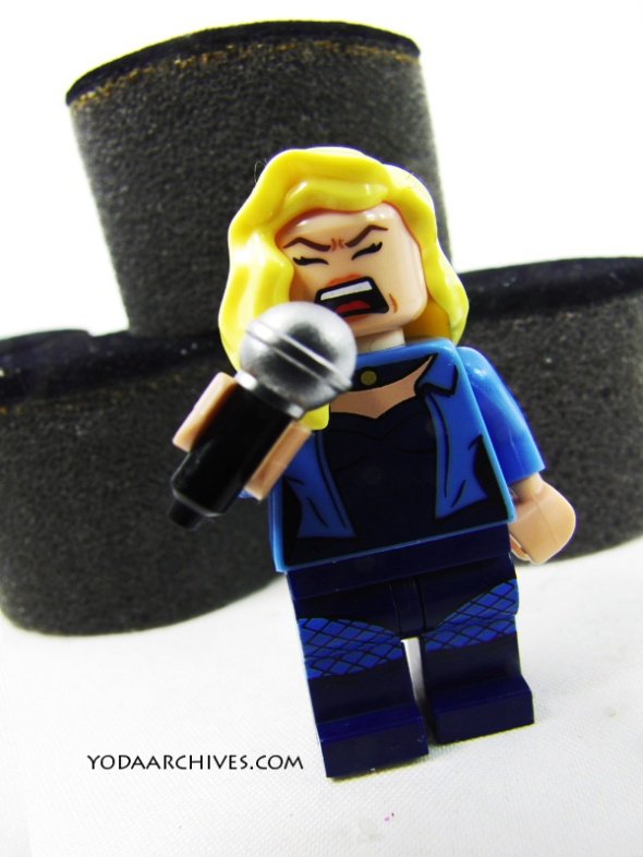 LEGO Black Canary minifigure singing into a microphone.