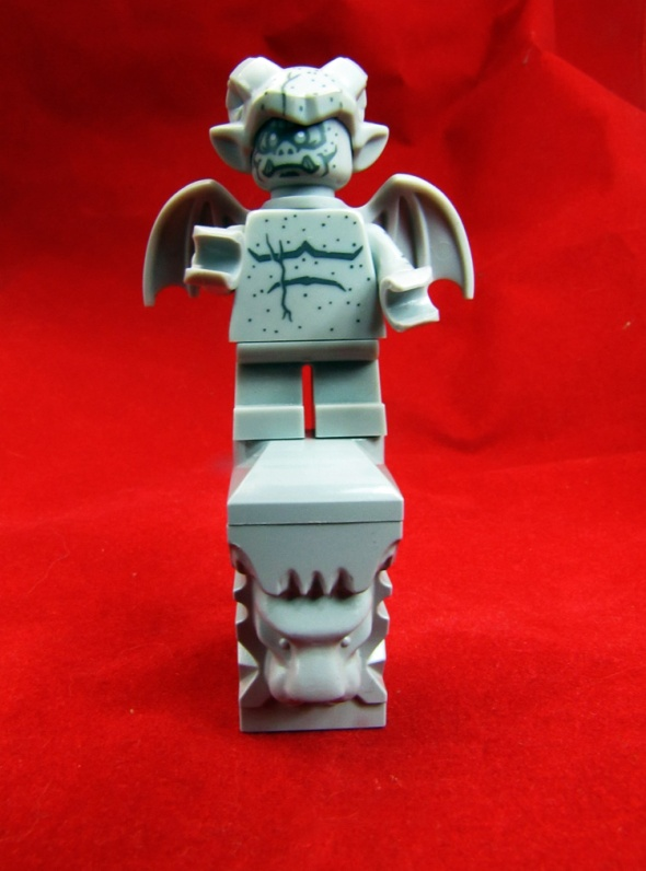 LEGO Gargoyle on top of stone lion head.