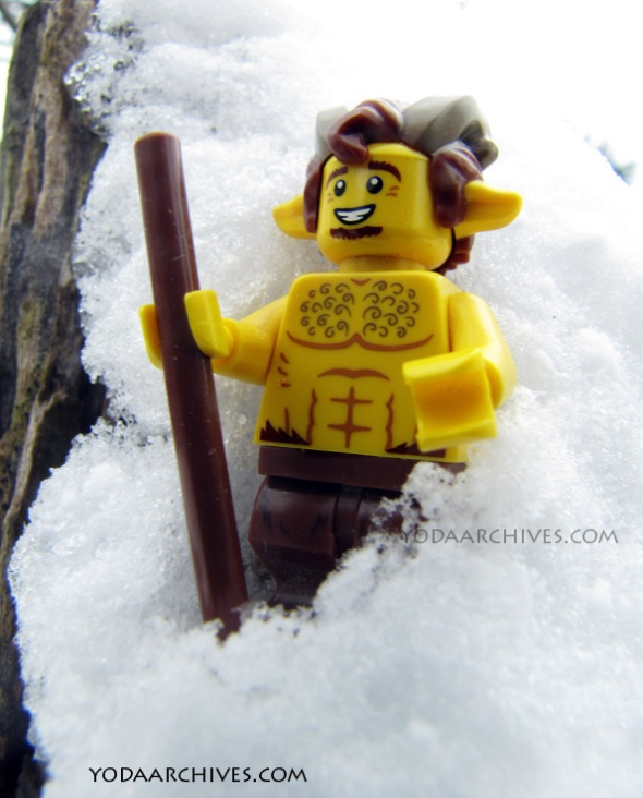 LEGO Satyr in snow. Satyr witha staff walking on s snowy hill.