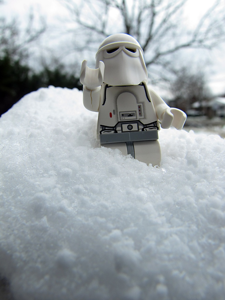 LEGO Snowtrooper on a hill of snow.