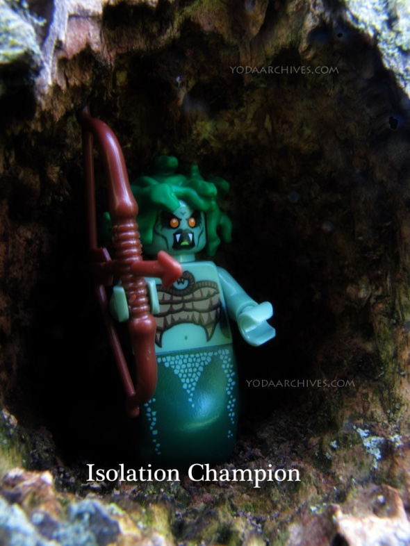 "LEGO MEDUSA in a cave. caption reads ""isolation champion."""