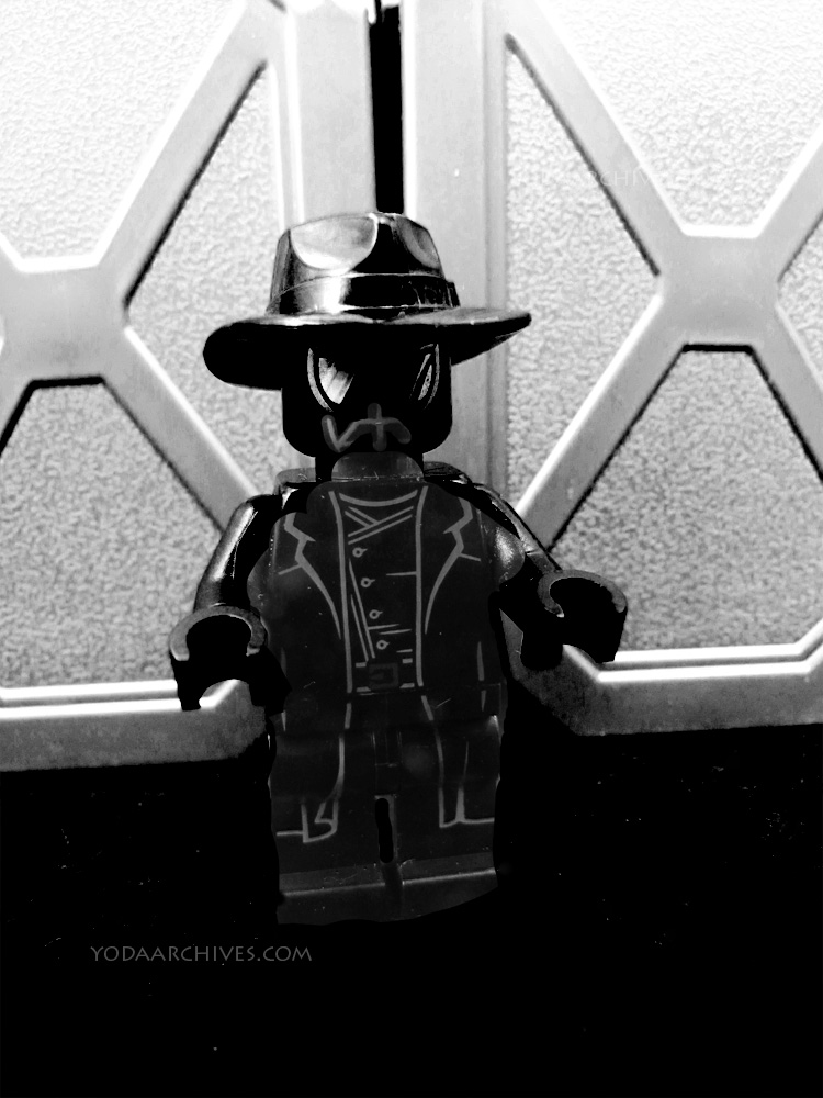 spider-man noir. A Spider-man in all black costume that looks like a pulp novel detective.