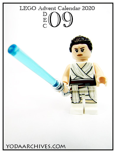 Rey mini figure with extended lightsaber.