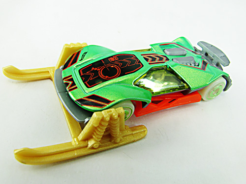 A hot wheels car on snow skis.