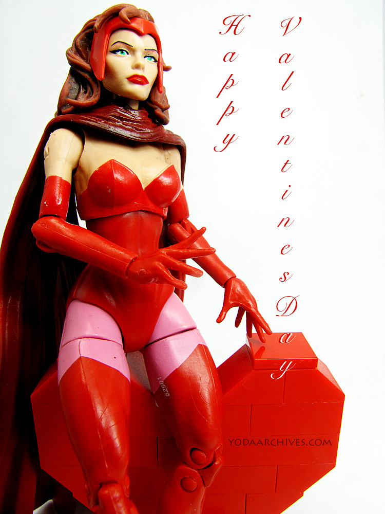 Scarlet witch sitting on a LEGO  Heart. Text says happy valentines day.
