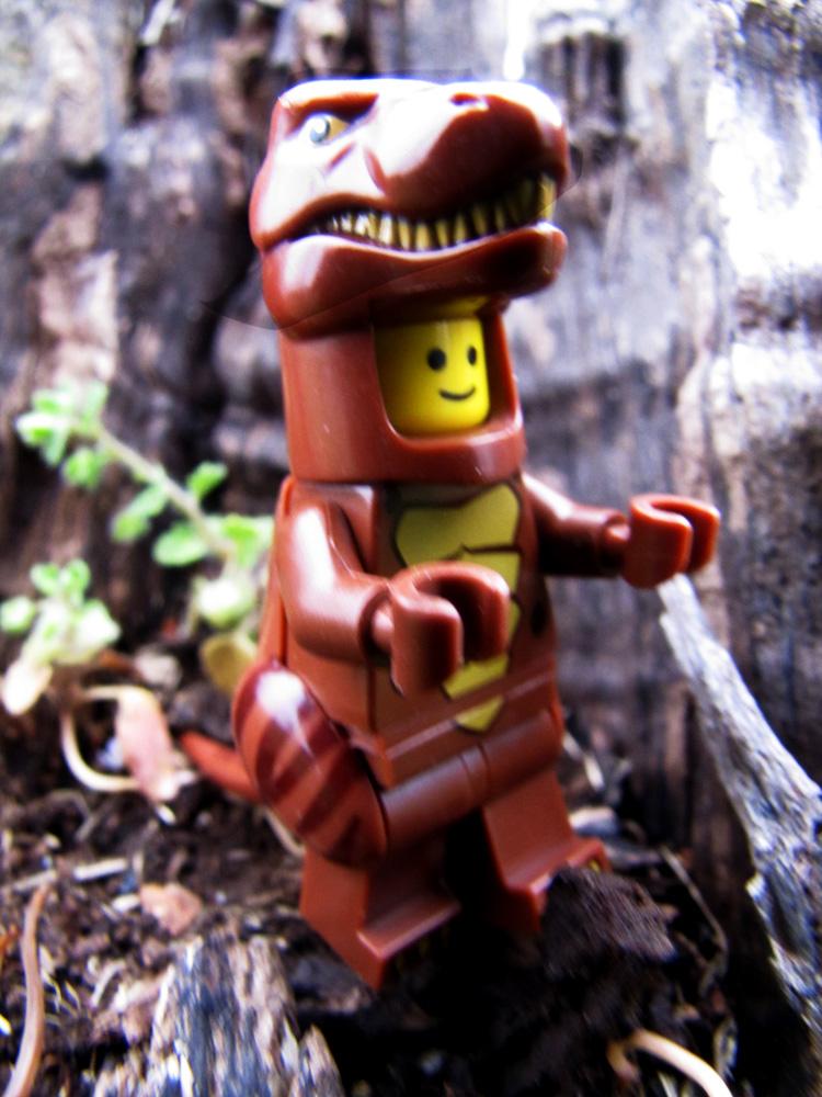 lego mini figure in a T-rex costume.