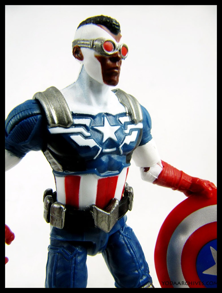 The Falcon in his Captain America costume. He is holding the sheild.
