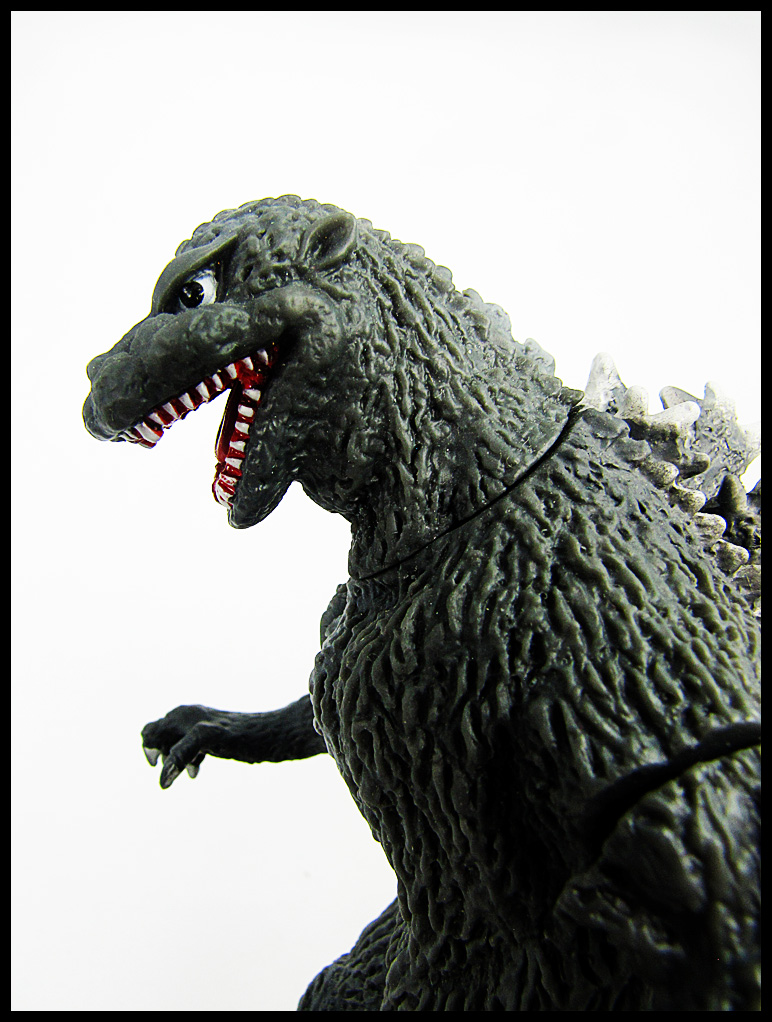 Godzilla toy. Close up of Godzilla he is facing left.