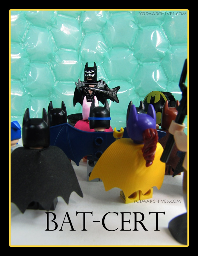 """LEGO Batman on a stage playing guitar. a cheering crowd is made of a variety of bat family. all have their back to view but are wearing cowls. The bat signal is on stage."""""""